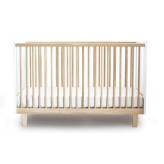 The Oeuf Rhea crib features warm wood tone side spindles with solid matte white end boards. Shop Oeuf cribs at Satara Home. Small Furniture, Nursery Furniture, Furniture Sale, Nursery Decor, Nursery Ideas, Nursery Inspiration, Project Nursery, Furniture Ideas, Furniture Design