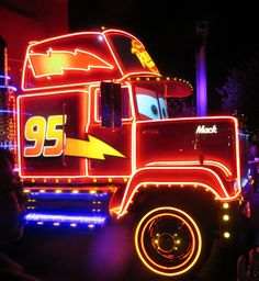 Mack, from Disney-Pixar Cars, in the Disney Paint the Night Parade at Disneyland in California. At 54-feet in length, Mack is the longest unit in this parade.  For more great Disneyland gems and secrets, see: http://www.buildabettermousetrip.com/disneyland-gems/