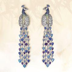 The royal gem-set peacock earrings transform their...