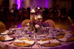One of my 2 table centerpieces at my wedding. (Florist: Fancy that! Designs, Photographer: Abby Sarno photography & More than words photography) #wedding #centerpiece #purple