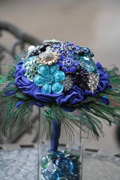 Brooch bouquet with peacock feathers