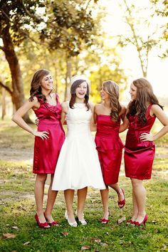 Scarlet bridesmaids dresses make a great red wedding theme.