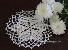This doily measures about 7 inches in diameter (across). I used size ten cotton thread and 1.2 mm hook. My free pattern is below. ...