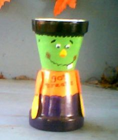 clay pot crafts | Two clay pots decorated to make a smiling Frankenstein monster candy ...