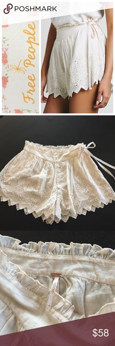 Free People skorts Free People Viola Lee eyelet skorts, size 6.  Stone color, ruffle waist with wide band, zip side with tie.  Scalloped hem with eyelet flower pattern.  So cute!  NWOT.  Note that there is a small hole near the zipper on the side where the tag once was. Free People Shorts Skorts