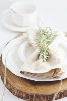 Coffee Stained Napkins Tied with Twine and Fresh Rosemary