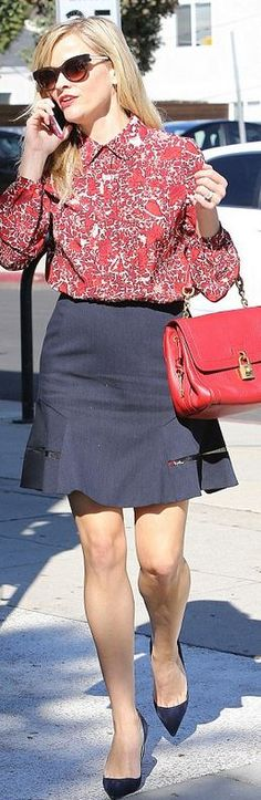 Who made  Reese Witherspoon's white print button down collar top, red lock handbag, black sunglasses, and blue suede pumps?