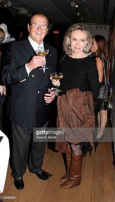 Sir Roger Moore (L) and Christina Tholstrup attend '50 Years Of James Bond: The Auction', celebrating the 50th anniversary of the film franchise and the first screening of Dr. No, at Christie's South Kensington on October 5, 2012 in London, England.