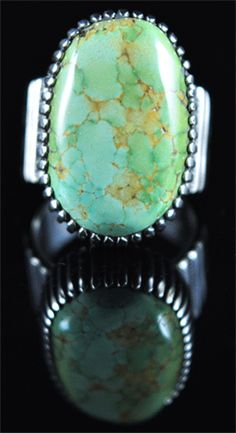 Handmade ring, with natural rare gem grade Carico Lake Turquoise, by Navajo artist Ned Nez.