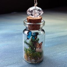 butterfly terrarium...Spring in a  mini bottle :) Beaded wire wrapped cork vial by beadingmom