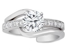 Round diamond Interlocking Bridal Set: Engagement ring. Daaaaaang!