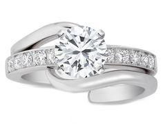 Round diamond Interlocking Bridal Set: Engagement ring. Daaaaaang!