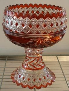 Vintage cut red crystal punch bowl with floral designs, top bowl comes apart from base, United States, nineteenth century; unmarked. Dimensions: 12H x 10 diameter