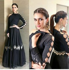 bollywood black embroidered partywear gown wear by kriti sanonFabric : Tapeta silk + Georget gown Length ( semi stich )bollywood black embroidered partywear gown - bollywood black embroidered partywear gown wear by kriti sanonFabric : Tapeta silk Indian Gowns Dresses, Pakistani Dresses, Indian Designer Outfits, Designer Gowns, Indian Attire, Indian Outfits, Stylish Dresses, Fashion Dresses, Sleeves Designs For Dresses
