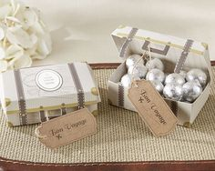 Fill vintage suitcase favor boxes by Kate Aspen with take home treats for guests