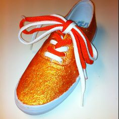 Glitter tennis shoes for my god daughter. Just started with canvas tennis shoes. Mixed hodge podge & glitter. Tape soles and paint, letting dry between coats. Add colored laces.