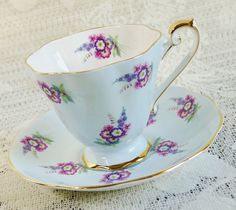 Beautiful Royal Standard pastel blue cup and saucer adorned with pink and purple floral bouquet and gold trim accents. Elegant fluted set!  In