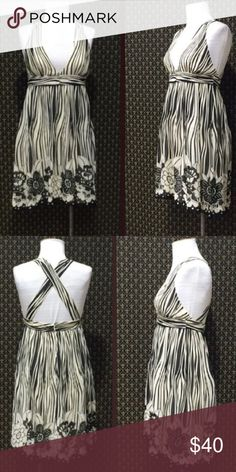 Alice + Olivia - Black/White Striped Halter Dress NWOT! Light silk with black and white stripes and modern floral print at the hem make this Alice + Olivia piece modern, playful, and guarantees you to be the fashion knockout of any soirée! Weddings, date night, GNOs-- this is the all purpose dress! Size S. Never worn except to try on. Originally purchased from Shopbop. 100% silk with 100% polyester lining. Alice + Olivia Dresses Mini
