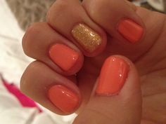 Coral with gold accent gel nails