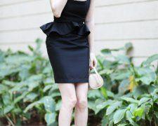 Win a feminine black peplum dress