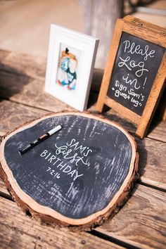 Log slice chalkboard from Grizzly Bear Man Cub 1st Birthday Party at Kara's Party Ideas. Must see inspiration at karaspartyideas.com!
