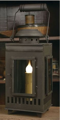 """This rustic brown Santa Fe Coach Light is 4.5""""  wide and 10"""" tall not including handle. A detailed lantern featuring glass on all four sides with a hinged door in the front and a handle.  $37.95"""