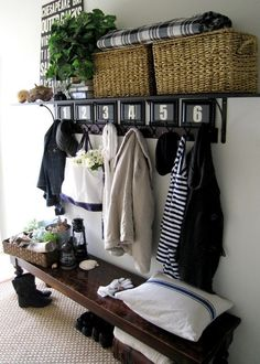 Coat hooks, shelf for winter gloves/hats/scarves, and low entry bench.
