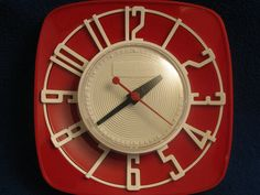 1950s MINT Red General Electric Topper Red 2H44 Electric Wall Clock with White Dials. $50.00, via Etsy.