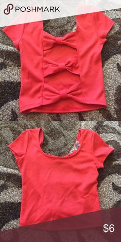 Charlotte Russe Peach crop top Bow detail on back. So cute! Worn once. Charlotte Russe Tops Crop Tops