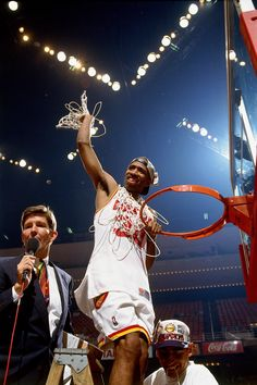 Kenny Smith cutting down the net after the 1995 Finals.    For the latest Houston Rockets news and updates, visit www.rockets.com.
