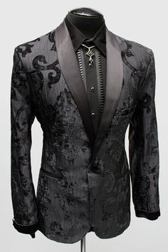 A super elegant gentleman's evening jacket. A deluxe 1950's style fitted gentleman's smoking jacket made in ultra-extravagant velvet brocade fabric. A satin shawl collar and matching satin cuff add an