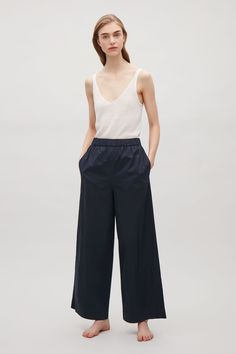 COS image 1 of Slip-on wide-leg trousers in Navy
