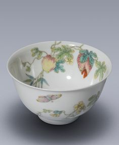 A FINE FAMILLE-ROSE 'FLOWERS AND BUTTERFLY' BOWL SEAL MARK AND PERIOD OF QIANLONG