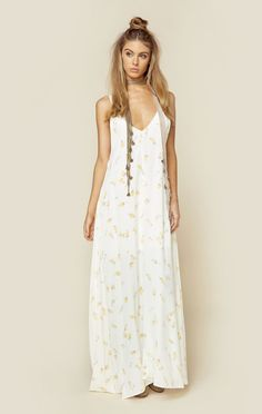 The Flynn Skye Arrow Maxi Dress is the perfect maxi with its all over floral print, deep v cut in the front and back, and a loose flowing fit.