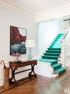 Kaling's best friend from Boston, artist Julia Powell, created two pieces of art for the entryway. The table formerly belonged to her parents | archdigest.com