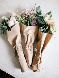 Fresh flowers wrapped in brown paper and tied in string