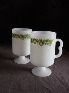 Vintage Pyrex Milkglass Crazy Daisy Green Spring Blossom Mugs... We don't have these mugs, but definitely have the plates and bowls to match. :)