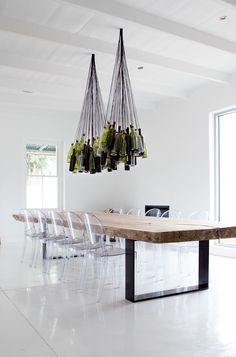 Minimalist Design With Acrylix Dining Chairs Wooden Dining Ttable And A Contemporary Ceiling Lights |www.bocadolobo.com #diningroomdecorideas #moderndiningrooms