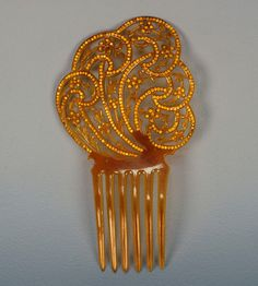 Hair comb | Early 20th c | Celluloid & rhinestones | Whitaker Auctions for $168