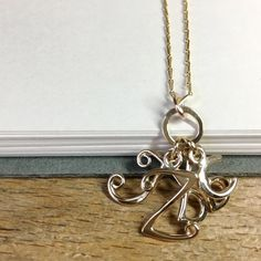 Honeybourne Jewellery . Bespoke . 9ct Gold Swirly Initials Cluster Pendant for a Mother .