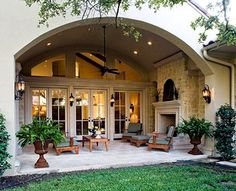 Love the arched opening and wall of french doors