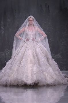 Uniq embroidered wedding dress bridal ball gown with boat neckline long sleeves a veil and cathedral train fall winter 2018 2019 haute couture collection fashion runway by ziad nakad novis fall 2018 ready to wear fashion show Stunning Wedding Dresses, Dream Wedding Dresses, Beautiful Gowns, Bridal Dresses, Wedding Outfits, Dresses Dresses, Bridal Collection, Couture Collection, Couture Wedding Gowns