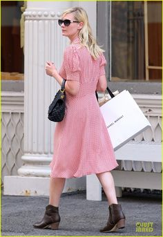 Kirsten Dust, chiffon dress with short boots. Image via Just Jared