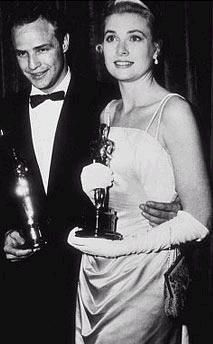 Marlon Brando & Grace Kelly holding their Oscars at 27th Annual Academy Awards, 1955
