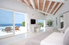 Spacious Mediterranean bedroom with a fantastic view