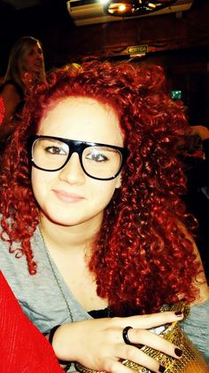 long curly kinky red hair. glasses