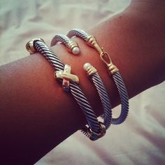 David Yurman. I really really love ALL THREE! Would be so cute for stacking!