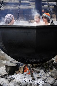 Can we say witches brew!  Yes, yes let's boil the guests…Tourists enjoying an outdoor bath at the Krasnaya Polyana ski resort outside Sochi on Jan. 8, 2012. Source: AFP / East News