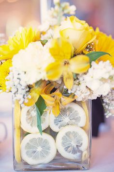 Lemon slices gave the florals a fresh and unique look.  Photo byPaper Antler Photography