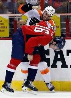 Philadelphia Flyers center Zac Rinaldo (36) fights with Washington Capitals center Michael Latta